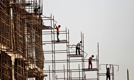 Labourers work at the construction site of a commercial complex in New Delhi