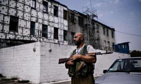 TOPSHOTS A rebel gunmen patrols in a yar