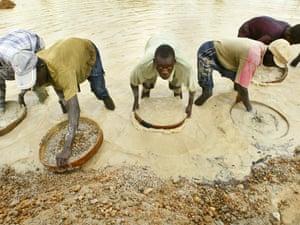 Miners pan for diamonds near Koidu in northeastern Sierra Leone.