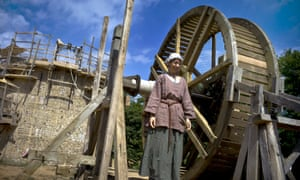 "A worker poses construction site of the ""Guedelon Castle"", an entirely new medieval castle built with 13th century techniques, in Treigny, central France."