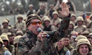 Comedian Robin Williams entertains a cheering crowd of US army troops at Baghdad airport in 2003.