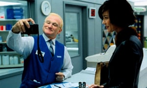 Robin Williams with Connie Nielsen in One Hour Photo, 2002.