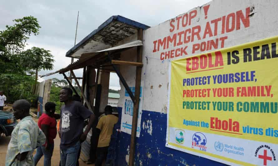 Ebola awareness signs at a checkpoint in Borni, Liberia.