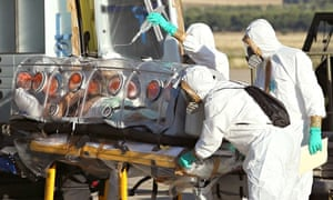 Doctors transferring Spanish priest Miguel Pajares who later died after contracting Ebola in Liberia