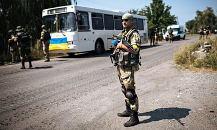 A Ukrainian soldier stands guard during an anti-terrorist operation against militants near Donetsk.