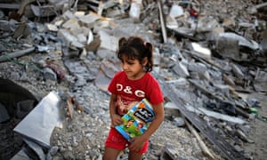 Palestinian girl Iman al-Masri in the rubble of her destroyed home in Gaza