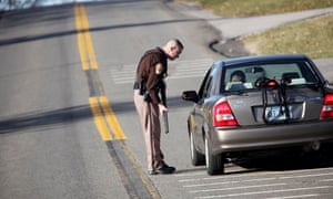 A Montgomery County law enforcement officer stops a car on Duckpond Road after a multiple shooting and ensuing campus-wide manhunt on Virginia Tech s campus today left two people dead in Blacksburg, Virginia
