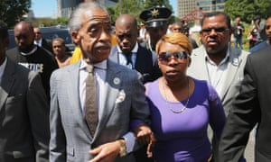 Lesley McSpadden, right, the mother of Michael Brown, arrives for a press conference on the arm of civil rights leader Rev Al Sharpton.