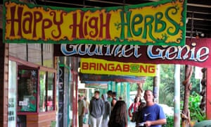 Tourists walk down the main street of Nimbin. Fire destroyed eight businesses.