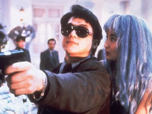 Jackie Chan as Boomer and Maggie Cheung as Barbara in Twin Dragons.