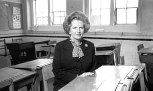 1982. Margaret Thatcher seated in the history classroom at her old school in Grantham.