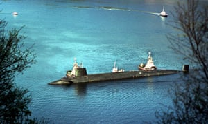 Trident nuclear submarine HMS Vengeance is escorted by tugboats into the naval base at Coulport, part of the Faslane complex.