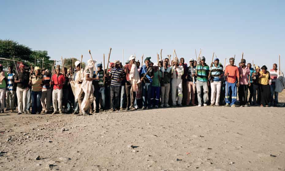 Striking platinum mine workers march together in Marikana, near to the site of 2012's massacre.