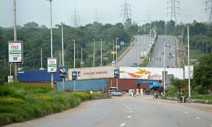 Police block a main road in Islamabad with shipping containers