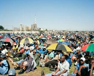 Striking miners gather at Wonderkop Stadium in Marikana