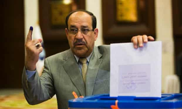 raqi Prime Minister Nouri al-Maliki casts his vote at a polling station in the green zone on April 30, 2014 in Baghdad.