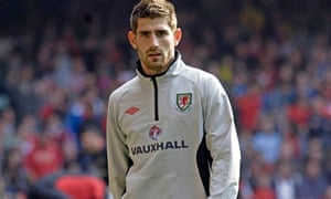 Ched Evans warming up for a Wales v England European championship qualifier, in March 2011.