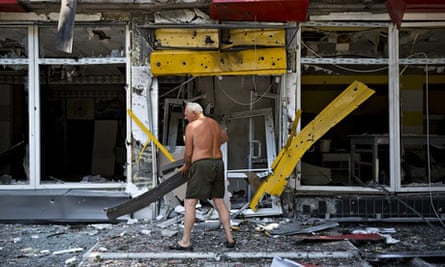 A man clears debris as the Ukrainian army retakes a village