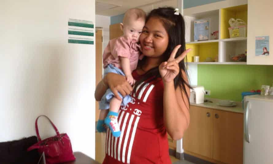 Thai surrogate mother Pattaramon Chanbua poses with baby Gammy.