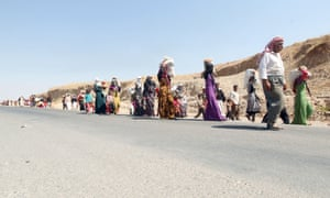 Displaced Iraqi families from the Yazidi community cross the Iraqi-Syrian border at the Fishkhabur crossing to safety, in northern Iraq, on Wednesday.