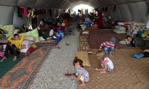Displaced Iraqi people from the Yazidi community are pictured in a refugee camp near the Turkey-Iraq border at Silopi in Sirnak on Thursday.