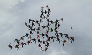 Sixty-three women from around the world break the previous vertical formation skydiving record