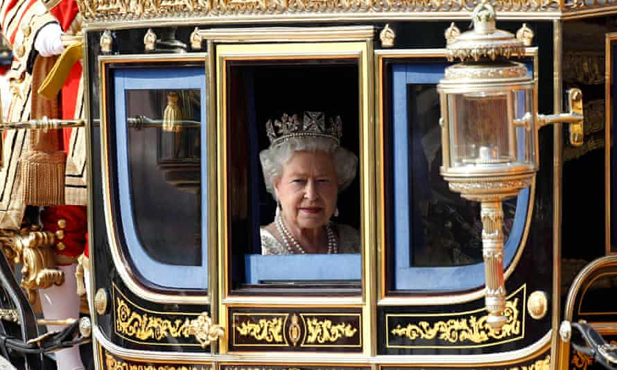 Queen Elizabeth in a horse-drawn carriage