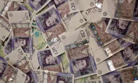 Pile of Twenty Pound and Five Pound Notes