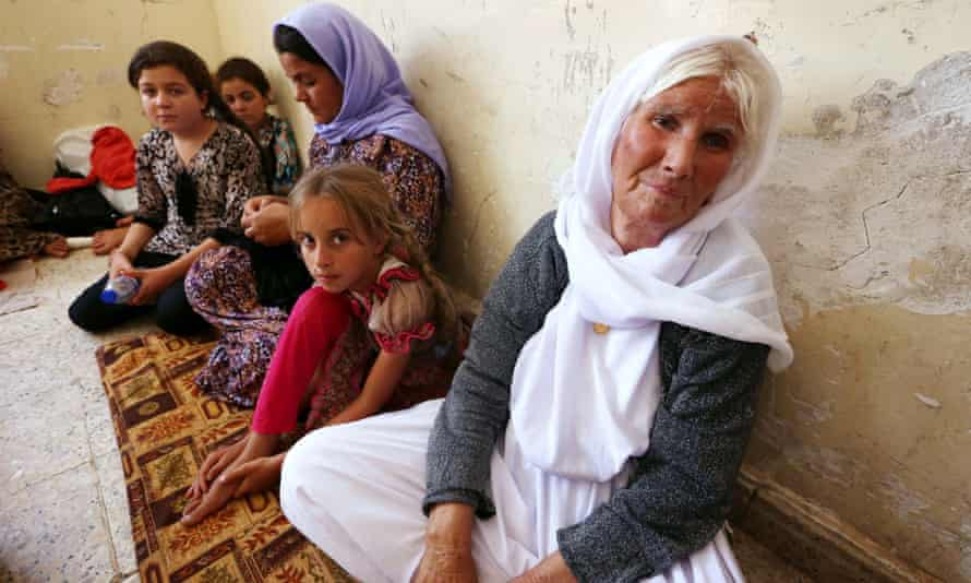 An Iraqi Yazidi family that fled the violence in Sinjar take shelter in the Kurdish city of Dohuk.