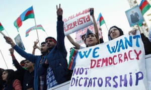 Protesters attend an opposition rally in Baku in 2013.