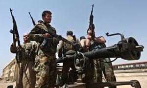 Kurdish peshmerga fighters on the frontline against Isis militants in Tuz Khormato, northern Iraq