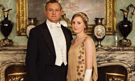 Downton Abbey promotional picture for fifth series, with modern bottle of water on mantelpiece