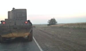 Armoured personnel carriers with Russian military plates move towards the Ukraine border