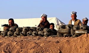 Iraqi Kurdish fighters take position behind sandbags