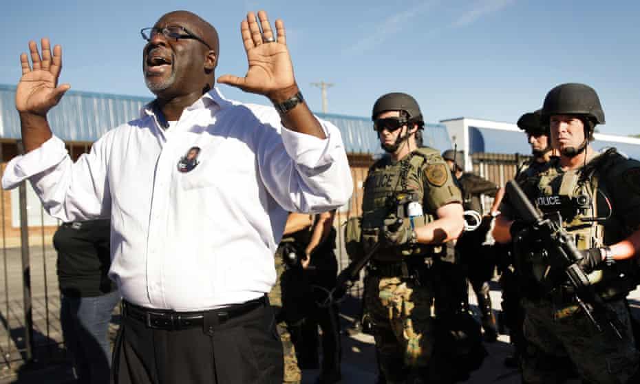 protestor hands up ferguson