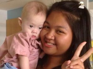 Surrogate mother Pattaramon Chanbua poses with baby Gammy in Bangkok.