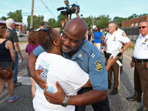 Captain Ron Johnson hugs a demonstrator after taking over the policing of protests in Ferguson, Missouri.