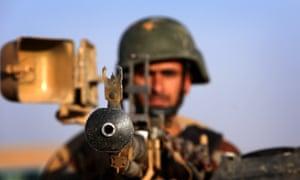 An Iraqi Kurdish Peshmerga fighter takes position on the front line in Khazer, near the Kurdish checkpoint of Aski Kalak, 40 km West of Irbil.