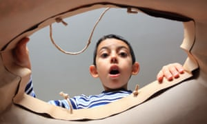 child looking inside bag with surprise