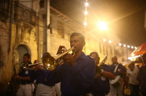 A marching band makes its way through the streets of Cachoeira in Brazil during the Festival of the Good Death
