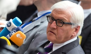 German Foreign Minister Frank-Walter Steinmeier speaks with journalists as he arrives for a meeting of EU foreign ministers in Brussels.