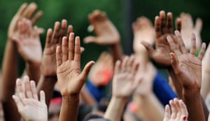 People put their hands in the air in Union Square, New York, in remembrance of Mike Brown, a young man who was killed in Ferguson, Missouri