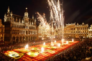 Fireworks explode above a giant flower carpet created to celebrate the 50th anniversary of Turkish workers' migration to Belgium at the Grand Place in Brussels, Belgium