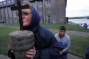 Kissing the cross at Station Island.