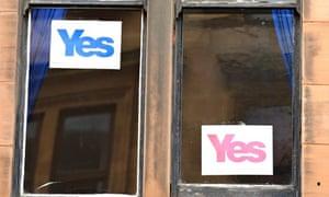 Stickers on a window in Glasgow.