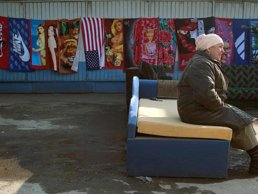 A woman sells towels in Kaliningrad, a Russian enclave sandwiched between Lithuania and Poland.