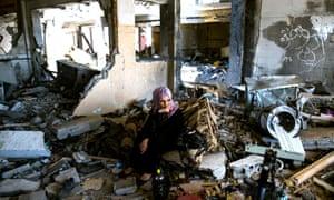 Adir Ali sits in her devastated flat in Beit Hanun, Gaza.