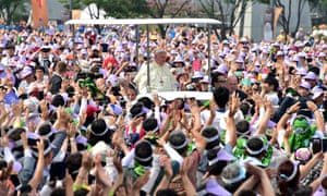 Thousands of people greeted Pope Francis on his arrival at Gwanghwamun Square in Seoul on Saturday.