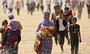 Yezidis trapped in the Sinjar mountains walk to safety
