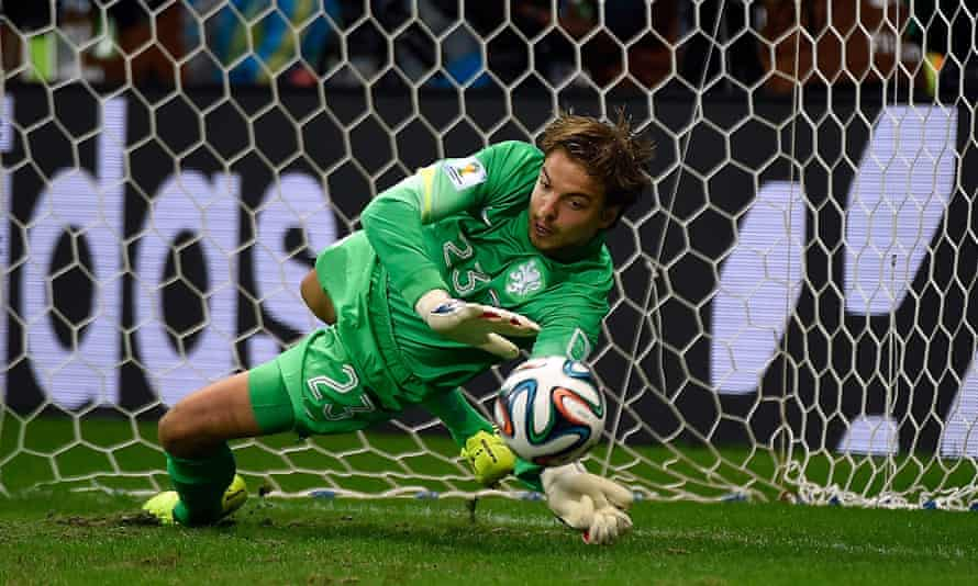 Netherlands' goalkeeper Tim Krul saves a penalty during the penalty shoot-out of the quarter-final football match between the Netherlands and Costa Rica at the Fonte Nova Arena in Salvador during the 2014 FIFA World Cup on July 5, 2014.